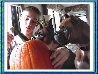Bella and Spencer helping to carve pumpkins :-))
